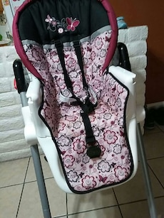 white, pink and black floral highchair