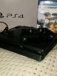 black Microsoft Xbox One with controller 43 km