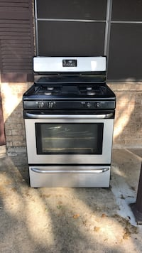 Stainless steel gas stove includes grills in great condition must pick up in Alamo