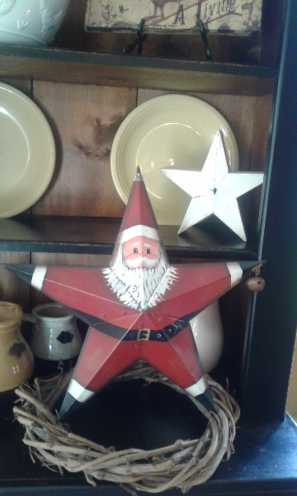 Tin starred Santa with bell