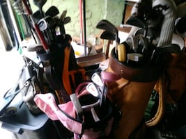 Golf clubs left hand right hand and a child set of golf clubs