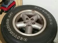 All 4 jeep rims with tires. Tires not great