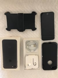 black iPhone 7 with EarPods, travel charger and two protective cases