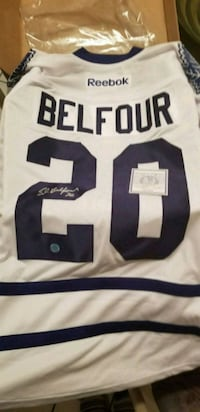 white and blue Reebok jersey shirt