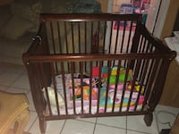 baby's brown wooden crib Miami, 33189