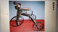WANTED TO BUY THIS ITEM ::SMALL CAST IRON TRICYCLE FOR DECORATION