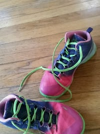pair of pink-and-green Nike running shoes