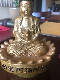 Small battery operated Buddha that sings prayers.   Los Angeles, 91344