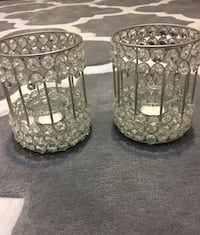 two clear glass candle holders New York, 10468