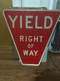 Vintage street sign. Yield right of way New York, 11385