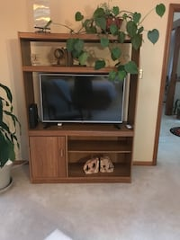flat screen television with brown wooden TV hutch Virginia Beach, 23456
