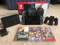 black Nintendo Switch with game cases Woodbridge, 22193