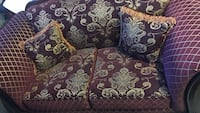 purple and white floral fabric 2-seat sofa
