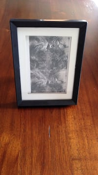 black wooden frame gray scale painting of a dragon