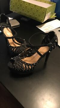 pair of black leather open-toe heeled sandals Conroe, 77304