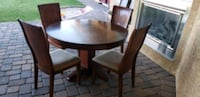 round brown wooden table with four chairs dining s Las Vegas, 89113