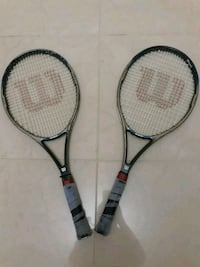 two black and white tennis rackets