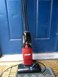 black and red Dirt Devil upright vacuum cleaner Houston, 77088
