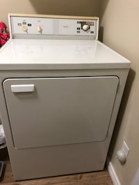 white front-load clothes washer 651 km