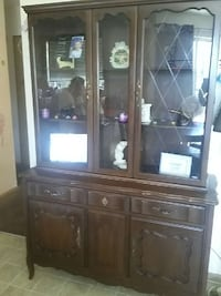 brown wooden framed glass cabinet\ Victoria, V8V 3L9