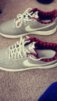 pair of gray-and-pink Nike running shoes