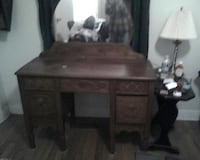 brown wooden desk with vanity mirror
