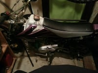 white,pink and black dirt bike