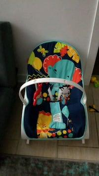 baby's blue and white bouncer Montreal