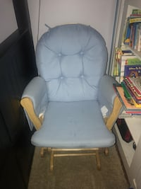 white wooden framed gray padded glider chair