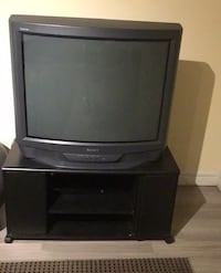 Free tv and stand. Pickup only