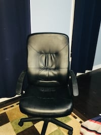 Black leather office rolling chair Vaughan