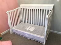 Baby's white wooden crib Sterling