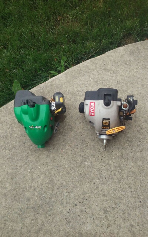 two green and black gas string trimmers