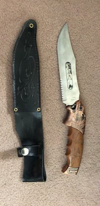 Black handled knife with sheath