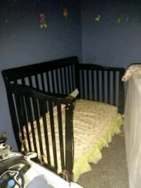 baby's black wooden crib
