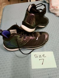 pair of brown-and-black Nike running shoes Leon Valley, 78238