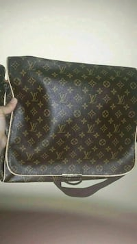 brown Louis Vuitton leather bag Regina, S4S 4H4