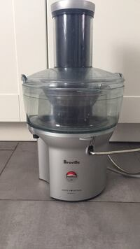 White and black breville juice extractor Toronto, M6J 2X6