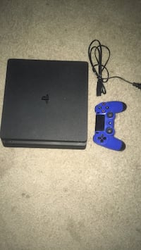 Black PS4 and blue and black controller