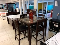 rectangular brown wooden table with six chairs dining set Houston, 77084