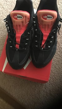 red-and-black Airmax basketball shoes with box