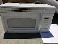 white General Electric microwave oven 2381 mi