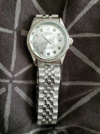round silver-colored analog watch with link bracel Mississauga, L5M 4Z5