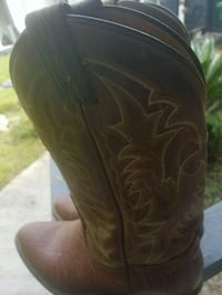 pair of brown leather cowboy boots Houston, 77016