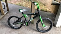 Black and green bmx bike. Barely used, looking for a buyer. Price is moveable. Includes training wheels Surrey, V4N 0P2