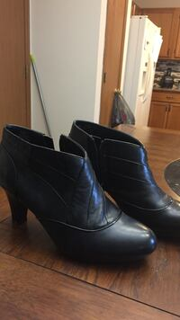 Pair of women's black leather side zip heeled booties O Fallon, 63366