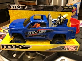 Blue and black mxs pickup truck toy