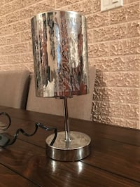 stainless steel base table lamp with brown lampshade Laval, H7C 2S6