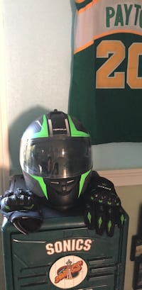 black and green full-face motorcycle helmet and two black-and-green racing gloves Edmonds, 98020