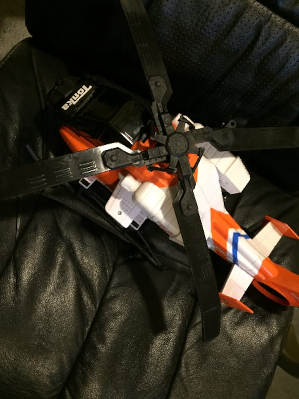 white, orange, and black Tonka helicopter toy cfbd3508-604c-481a-bc89-694ec5240561